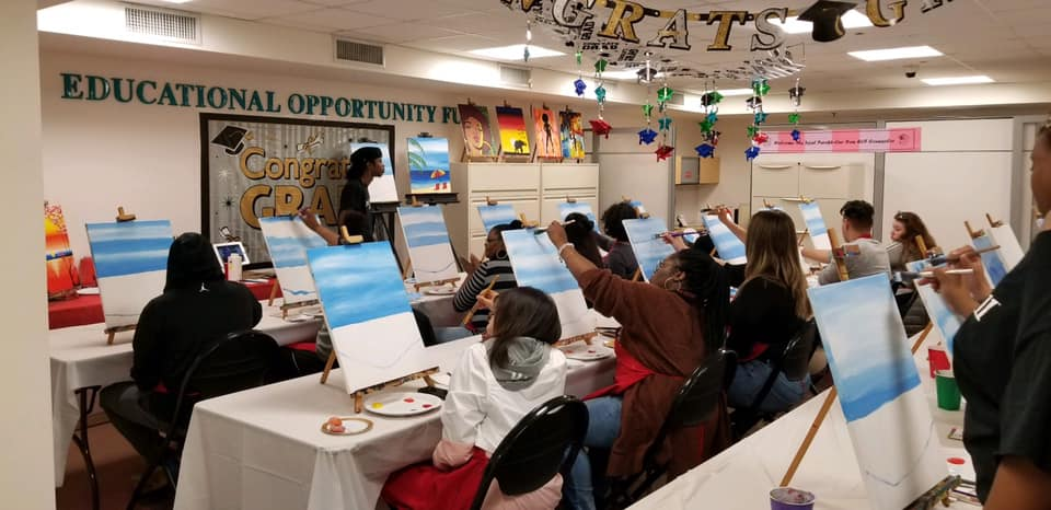 This is an image of students on the EOF space being instructed in a painting class
